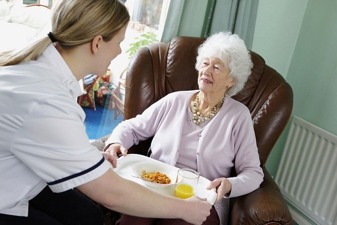 carer giving resident tray of food2.jpg